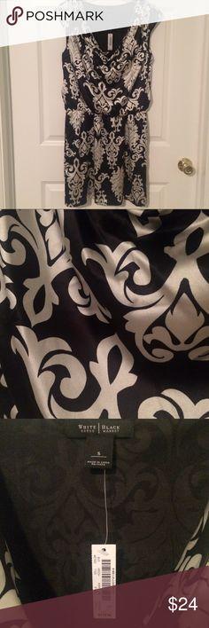 "NWT White House Black Market silky dress New with tags silky black and white dress from White House Black Market. Cowl neck, elastic waist. Measures 18"" across chest; 14.5"" at elastic waist; 34"" in length. White House Black Market Dresses Mini"
