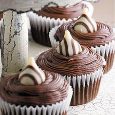 2-Kiss Cupcakes Recipe Desserts with butter, sugar, eggs, vanilla extract, all-purpose flour, cocoa, baking soda, baking powder, salt, water, milk chocolate, margarine, cocoa, milk, vanilla extract, powdered sugar