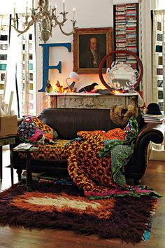 via anthropologie. has pieces of my aesthetic- gold frames, saturated colors in quilts and blankets, animal life figurines, stacked books, music