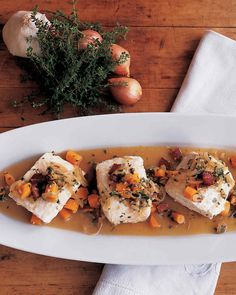 """Halibut is braised in white wine and flavored with bacon and carrots, a preparation known as """"a la Barigoule"""" that was inspired by a Provencal peasant dish."""