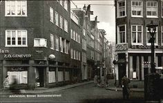 1940. View on the crossing Geldersekade and Binnen Bantammerstraat in Amsterdam. The Binnen Bantammerstraat is located in the Chinese section of the city around the Geldersekade and Zeedijk. The Geldersekade is canal and street that connects the Nieuwmarkt with the Prins Hendrikkade. The canal was constructed in the late 15th century. Together with the Kloveniersburgwal and the Singel it served as a moat around the city. Photo B. Kooiker. #amsterdam #1940 #Geldersekade.