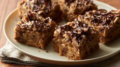 We all love the original Oatmeal Carmelitas (a favorite from the 1967 Pillsbury Bake-Off®), so we hacked the recipe with ready-to bake dough to create these irresistible oatmeal cookie bars filled with gooey salted caramel and studded with chocolate.