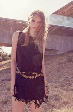 Channeling 20's fashion! Can't get enough of this tassel embellished shift dress.