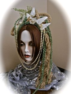 Do you dare?  This one of a kind headpiece was lovingly made by me to turn you into a sea siren, mermaid queen or daughter of Neptune on your