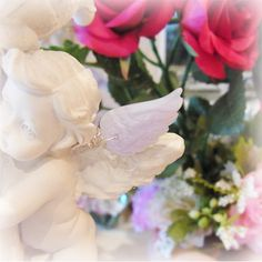 """The silver pierced earring - crystal of an angel's feather, an angel, and healing one-house house"""" Crystal Garden Mejiro """""""