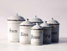 Vintage white French enamel canisters.