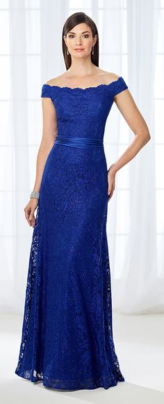 Accented with sparkling heat set stones from top to bottom, this scalloped off-the-shoulder satin and allover lace fit and flare gown offers a gathered satin natural waistband and a fitted skirt that gradually flares out. A matching shawl is included.