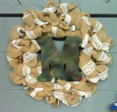 Burlap n Lace wreath with a Camo M and shotgun casings
