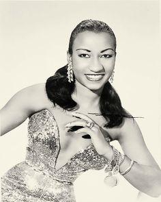 Celia Cruz----> love her! Look at the dress! Muy calienté!
