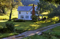 A farmhouse in the early morning light beside the Blue Ridge Parkway in Ashe County, North Carolina.