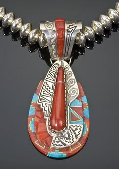 Necklace | Abraham Begay. Sterling silver with a pendant inlayed with Mediterranean coral and turquoise