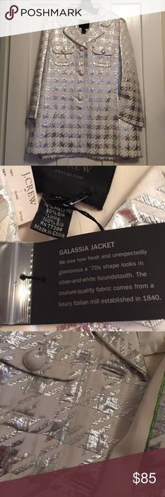 """Fabulous J. Crew Collection Galassia jacket Truly a collector's piece and perfect for any festive occasion! j. Crew """"Galassia"""" jacket in silver / white houndstooth abounds in charm. Dressmaker details include bound buttonholes, self-fabric dome buttons, on-seam pockets and sparkly inside piping (photo 3). The fabric is 77% cotton/13% metallic/10% silk; 100% silk lining. Size 10. Trapeze shape is 28"""" long center back from base of collar. Bustline is 20"""" pit to pit; bell sleeves 20"""" (bracelet)…"""