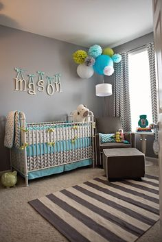 Soothing grey walls for a nursery, using grey and white stripe rug. Blue and green accent colours are gender-friendly for a boy or girl.