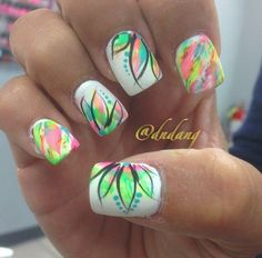 Be bold and have fun. This creative nail art design gives you an idea that sometimes; the wackier the colors are the better they look altogether. Play with your nails with this white coated background polish and add multi colored flower and leaves accents to make you stand out from the rest.