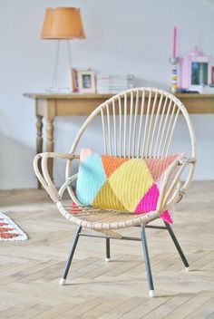 Vintage retro cane saucer chair with colourful knitted cushion