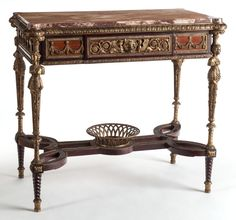 French, A CHARLES X GILT BRONZE MOUNTED MARBLE TOP CENTER TABLE. Mid-19th century.