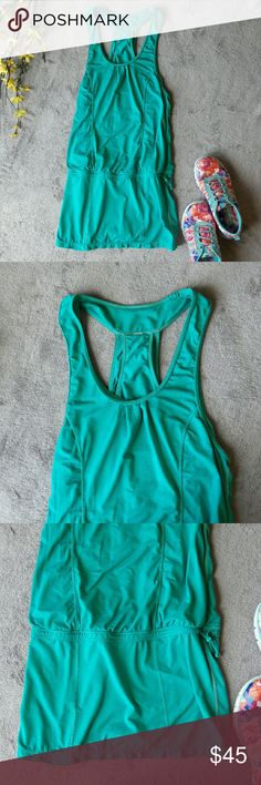 Lululemon Run for Fun tank top dress blue teal Lululemon's Run for Fun dress in teal blue. A size two. Double layer top with an elastic waistband. Small pocket in inner layer of top. 31 inch length, 26 inch bust. No holes or stains. lululemon athletica Dresses