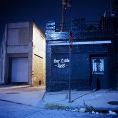 Baltimore by Patrick Joust This Photograph is an example of an Urban environment.  The combination of the wide angle, use of space in the image, solitude of the environment and the contrast between high and low light all work together to create this well balanced urban environment. the writing on the wall 'our little spot' also adds to the feel that this is a place where there should be people.