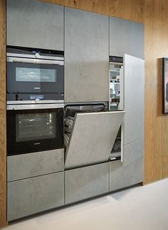 The freestanding kitchen island presents itself as chiseled from one piece in . - The free-standing island in ceramic concrete gray replica appears as if it were carved from one pie - Kitchen Desks, Modern Kitchen Cabinets, Home Decor Kitchen, Kitchen Interior, Kitchen Storage, Kitchen Island, Kitchen Organization, Miele Kitchen, Backyard Kitchen