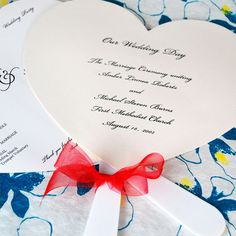 Heart Shaped Wedding Program Fans by Beau-coup.  Not sure if you are going to have fans - they can be distracting, but might need them if it is hot???