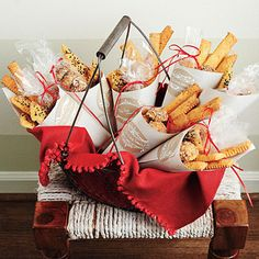 A (Not-So) Cheesy Gift  Turn our cheese straw varieties into the perfect party favor with simple wrapping.    Wrap the straws in Oyster Book Cloth cones and seal with Super Tacky Tape. Add decorative gift labels and place in cellophane bags.