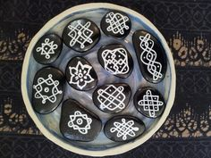 kolam style - painted stones and draw with white pen