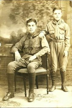 SCOUTING: Portrait of two brothers and proud Boy Scouts, c. 1918. The Boy Scouts (of America) were incorporated in 1910 and received a congressional charter in 1916. The charter was symbolic and honorific. It would be granted to the Girl Scouts, too.