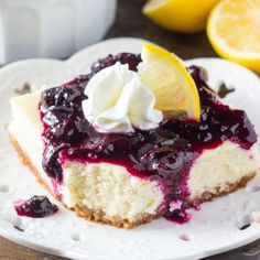 Lemon blueberry cheesecake squares are smooth & creamy with a delicious lemon flavor and crunchy graham cracker crust.