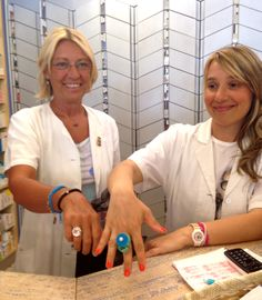 In the oldest pharmacy of Arezzo, Teresa and Stefania are working wearing multicolor rings of Floral Collection by Scicche and Sillymond rings for Scicche www.scicche.it