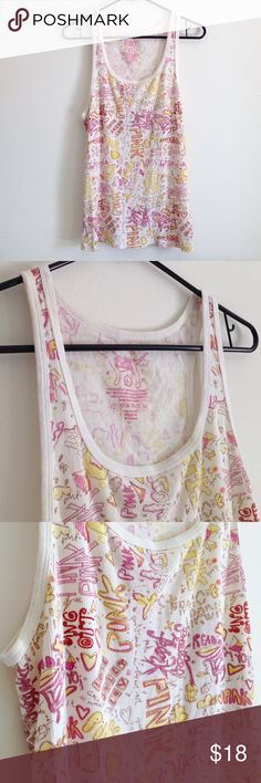"""Pink VS Tank Top Cute tank top - stretchy. Yellow, tan, pink and black printed. 97% cotton and 3% spandex. Measurement laying flat: bust: 16"""" length: 26"""". Worn few times - no stains or holes. One small area have dark cream on one strap - but hard to see. I my best to take picture above. PINK Victoria's Secret Tops Tank Tops"""