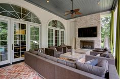 6 Fleury Way The Woodlands, TX 77382: Photo A relaxing outdoor setting. Outdoor living space offers stone fireplace with big screen TV, bead board ceiling with recessed lighting, in-ceiling speakers, ceiling fans. Overlooks beautiful pool and yard.