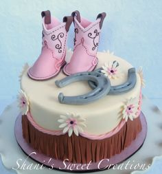 - Sweet Baby shower cake with baby cowboy boots, horseshoes and western fringe.