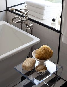"""ANN SACKS White Thassos 3"""" x 6"""" marble field in honed finish with Nero Marquina 3"""" x 6"""" field and  9/16"""" x 8"""" marble box liner in honed finish and Kohler Reve freestanding bath and Finial traditional faucet with handshower (location: Veranda show home in New York; designer: S. Russell Grove)"""