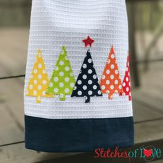 The O Christmas Tree Towel Kitt includes the towel with fabric accent border, pre-fused, laser cut applique pieces, and easy to follow pattern.
