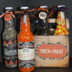 Empty soda bottles filled with candy and covered with paper.