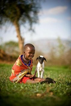In Kenya, Namanyak, age 6, plays with a lamb, made possible through the World Vision Gift Catalog.