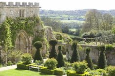 Enjoy the topiary gardens and fragrant rose beds