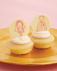 Small cupcakes from Baked by Melissa are crowned with white-chocolate discs printed with sketches of the bride and groom