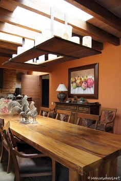 I love the warm wall color and roosters . comedor mexicano / Mexican dining room | Casa Haus