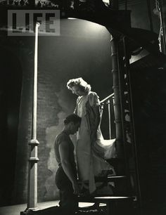 """Marlon Brando kneels before Kim Hunter in a touching scene from the Broadway production of Tennessee Williams' ""A Streetcar Named Desire"". 1947."""