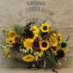 Image result for artichoke sunflower centerpiece