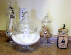 Apothecary jars in my Laundry Room. Filled with old clothes pins, laundry detergent powder, spools, thread, etc.