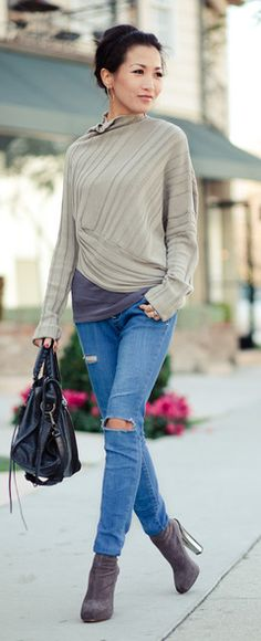 asymmetrical sweater and ripped jeans
