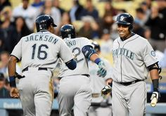 LOS ANGELES, CA – APRIL 14: Nelson Cruz #23 of the Seattle Mariners celebrates a two run homerun of Robinson Cano #22 with Austin Jackson #16 to take a 2-0 lead over the Los Angeles Dodgers during the first inning at Dodger Stadium on April 14, 2015 in Los Angeles, California. (Photo by Harry How/Getty Images)