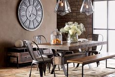Great setup...love the rustic stone & earth tones with the clock and the lighting