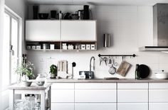 Displaying kitchen accessories makes the most of unused wall space