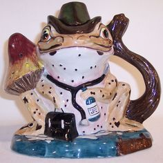 Dr. Froggatt from the Woodland Collection. This adorable pitcher is in the shape of a frog sitting on a toadstool. Dr. Froggatt is his name and he is ready for surgery! Don't wait to add this to your collection!