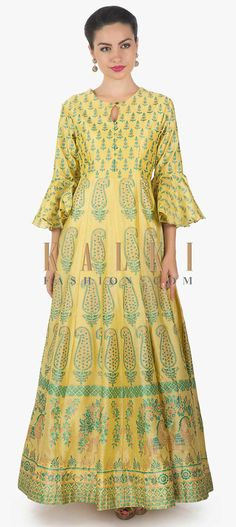 Buy Online from the link below. We ship worldwide (Free Shipping over US$100)  Click Anywhere to Tag Light yellow long dress in floral printed kali only on Kalki Light yellow long dress featuring in mul cotton.Its kali is enhanced in floral print.Along with potli buttons along the placket.It comes with highnecklien and full sleeve.