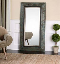 Bronwen Distressed Tall Mirror Western Mirrors - Stately mirror featuring a frame finished in heavily distressed teal blue and olive accented with aged black inner edge and rust brown undertones. May be hung horizontal or vertical. Mirror is beveled.