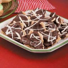 """Saltine Toffee Recipe -""""Easy to prepare using pantry staples, this recipe is always a hit,"""" writes Jo Ann Dalrymple from Claremore, Oklahoma. Her sweetly unique bites start with saltine crackers and are drizzled with white chocolate for an elegant and easy accent."""